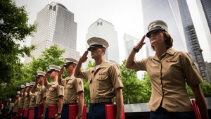 Members of the U.S. Marine Corps salute during a promotion ceremony at the National September 11 Memorial, New York