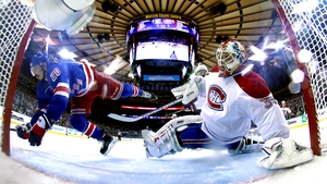 Members of the New York Rangers and Montreal Canadiens clash during the NHL Stanley Cup playoffs at Madison Square Gardens, New York