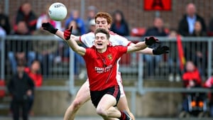 Tyrone's Peter Harte and Conor Maginn of Down
