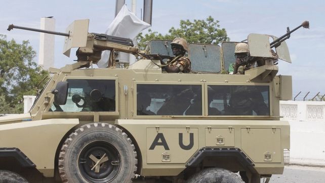 African Union troops arrive in an armoured vehicle during an attack on the Somali parliament