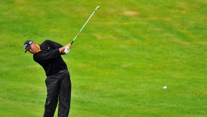 Thomas Bjorn plays his approach shot to the green on the fourth hole
