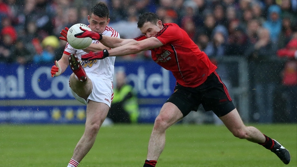 Tyrone's Darren McCurry with Down's Declan Rooney