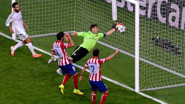 Real Madrid's Iker Casillas fails to stop Diego Godin's header