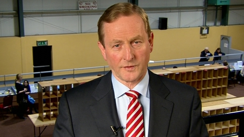 "Enda Kenny said he looked forward to ""a changed environment in Irish politics"""
