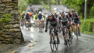 The peloton pedals through the rain in Thomastown