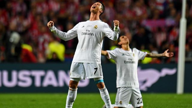 Cristiano Ronaldo and Angel Di Maria celebrate the final whistle in Lisbon.