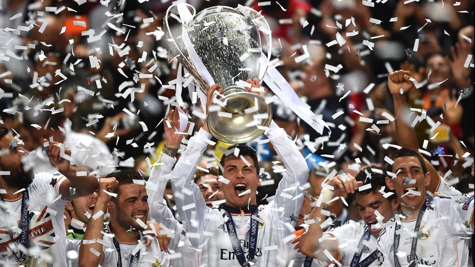 Real Madrid's Cristiano Ronaldo holds the Champions League trophy aloft