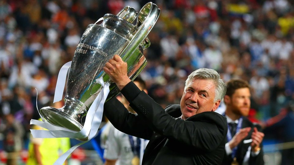 Real Madrid boss Carlo Ancelotti celebrates winning his third Champions League crown as a manager