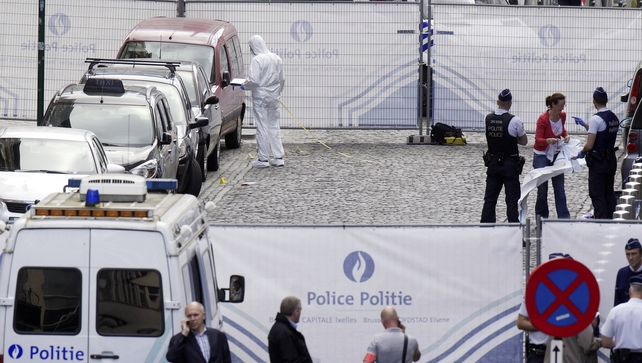 Police forensic experts search for evidence on the scene of a shooting near the Jewish Museum in Brussels