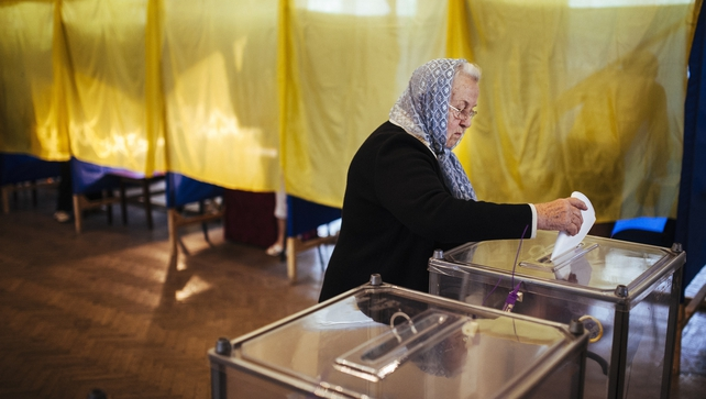 A woman casts her ballot in a polling station in the eastern Ukrainian town of Dobropillya