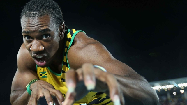Yohan Blake poses after breaking the world record for the 4x200 metres