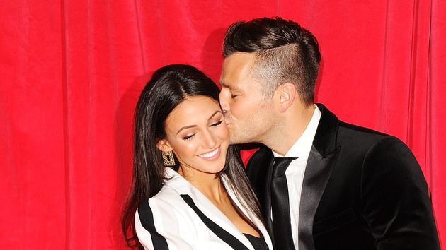 Mark Wright puckers up to his fiancée Michelle Keegan on the red carpet