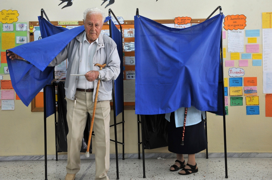 A man leaves a voting booth in a polling station in Thessaloniki, Greece