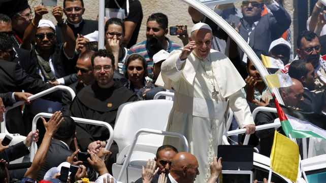Pope Francis waves to the crowd in Manger Square from his popemobile