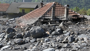 A view of a house that was struck by mud and stones in landslides following the floods in the Bosnian village of Topcic Polje, near the Bosnian town of Zenica