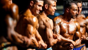 Bodybuilders strike a pose during the final event of the World Amateur Bodybuilding Association fitness and bodybuilding championships in Epalinges near Lausanne