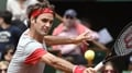 Federer cruises through French Open first round