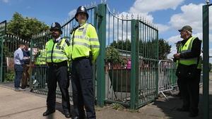'Ello, 'ello, 'ello. Policemen stand guard outside London's ground in Ruislip
