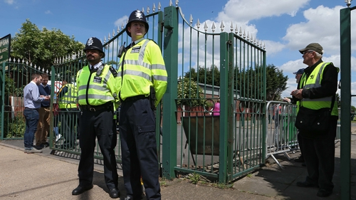 'Ello, 'ello, 'ello. Policemen stand guard outside London's ground in Ruislip