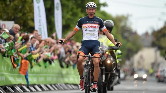Davide Ballerini roars in celebration as he crosses the finish line