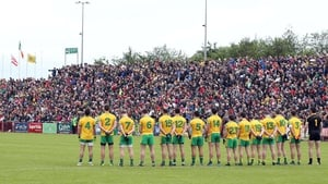 Donegal players line up for the national anthem before their tie with Derry