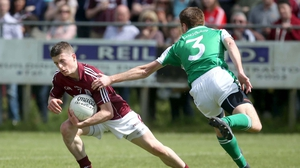 Galway's Paul Varley evades the attention London's Stephen Curran