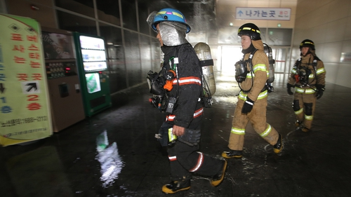 Firefighters rush to the inter-city bus terminal in Goyang