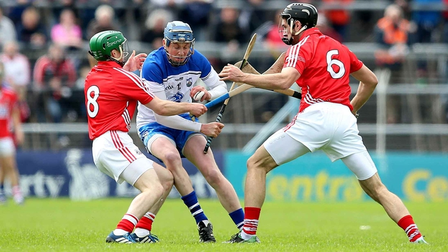 Austin Gleeson of Waterford is challenged by two Cork players