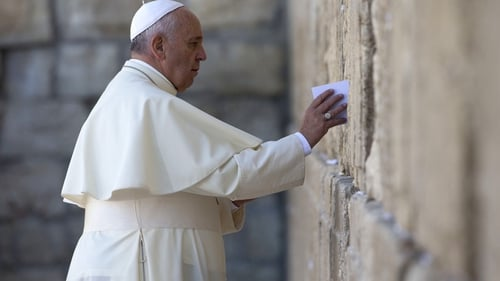 Pope Francis leaves a card at the Western Wall in Jerusalem's Old City