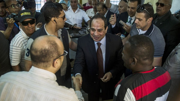 Egypt's ex-army chief and leading presidential candidate Abdel Fattah al-Sisi (Centre) arrives to vote in Cairo