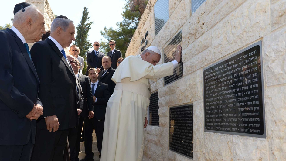 Israeli President Shimon Peres and Prime Minister Benjamin Netanyahu accompany Pope Francis as he visits the memorial monument commemorating victims of terrorist acts on Mount Herz
