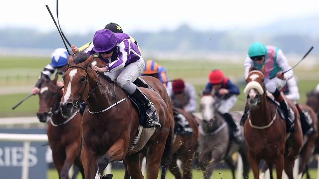 Ryan Moore on Marvellous gets ahead of Harry Bentley in the yellow and black silks on Lightning Thunder