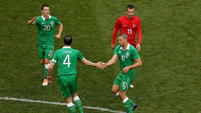 John O'Shea celebrates with Jon Walters after the latter's goal against Turkey