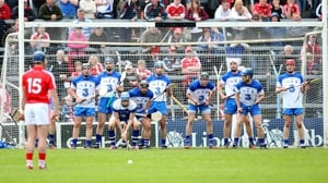 Patrick Horgan lines up a free with a wall of Waterford defenders standing in his way