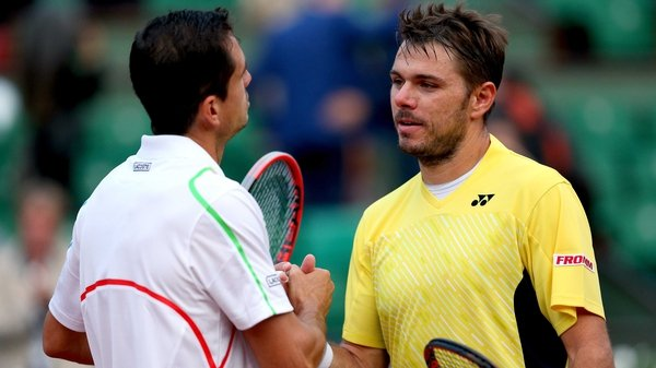 The vanquished Stanislas Wawrinka is consoled by Guillermo Garcia-Lopez