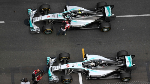 Lewis Hamilton's and Nico Rosberg's Mercedes cars sit side-by-side after the Monaco Grand Prix