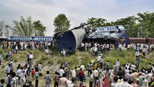 The passenger express train ploughed into a stationary freight train at a local station