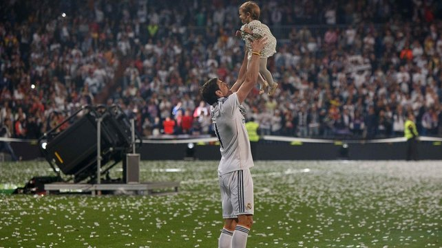 Gareth Bale celebrates his Champions League win with his daughter