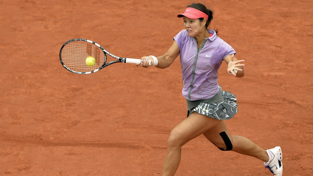 Li Na stretches to return a shot against Kristina Mladenovic during their first-round French Open match