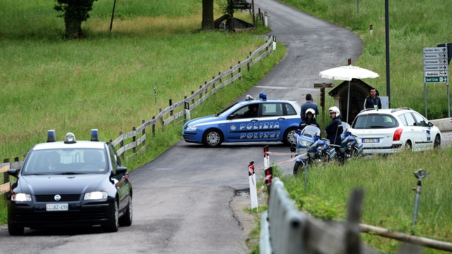Italian police close a road following an accident near Germany's training camp in San Martino