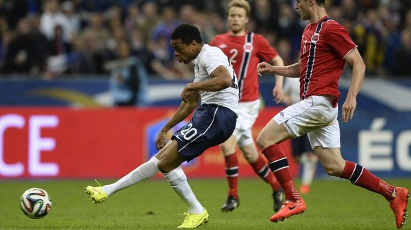 Loic Remy slots home France's third goal against Norway