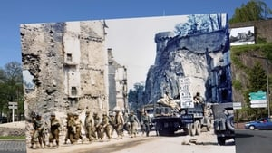 US Army vehicles drive through the ruins of Saint-Lo, which was destroyed during the Allied bombing campaign