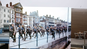 US troops on the Esplanade at Weymouth in Dorset on their way to embark on ships bound for Omaha Beach