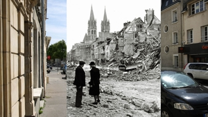 An older couple watch a Canadian soldier with a bulldozer working in the ruins of a house in the rue de Bayeux in Caen