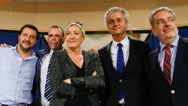 The National Front leader (centre) with other far-right figures