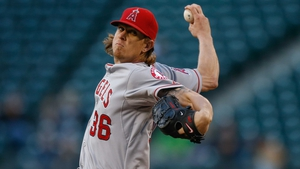 Jered Weaver of the Los Angeles Angels of Anaheim pitches in the third inning against the Seattle Mariners at Safeco Field