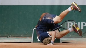Russia's Dmitry Tursunov falls down during his French Open second round match against the USA's Sam Querrey