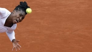 Venus Williams eyes the ball during her French Open second round match against Slovakia's Anna Schmiedlova