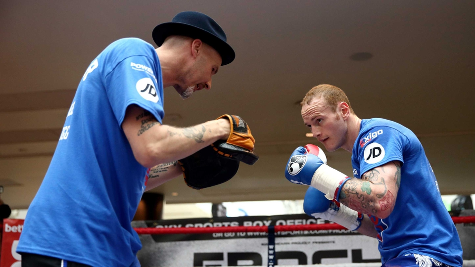 George Groves (R) works out with his trainer Barry Fitzpatrick ahead of his fight against Carl Froch