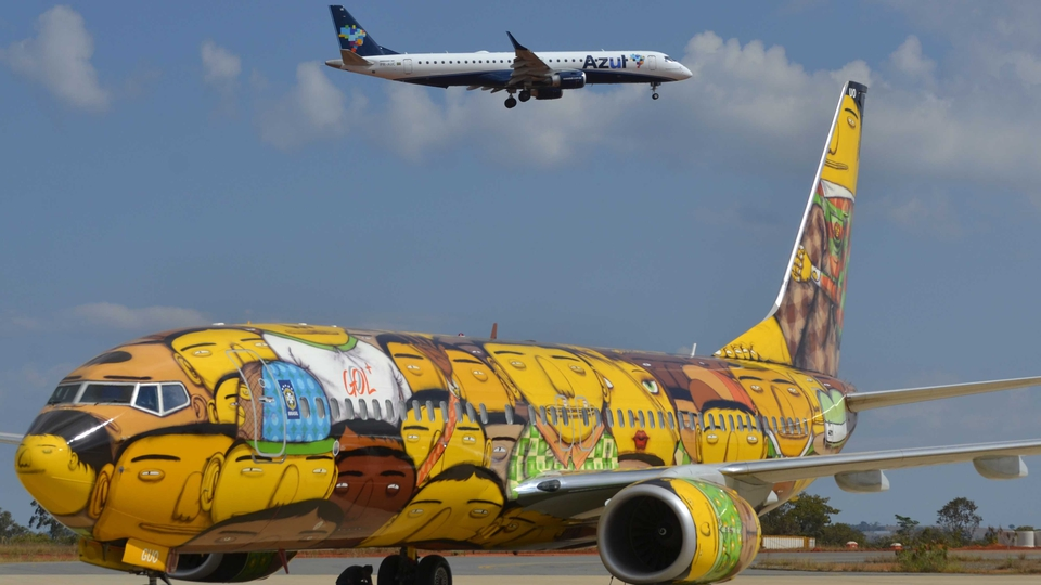 The airplane that will transport the Brazilian national football team across the country during the FIFA World Cup Brazil 2014,  painted by graffiti artists and identical twin brothers Otavio and Gustavo Pandolfo